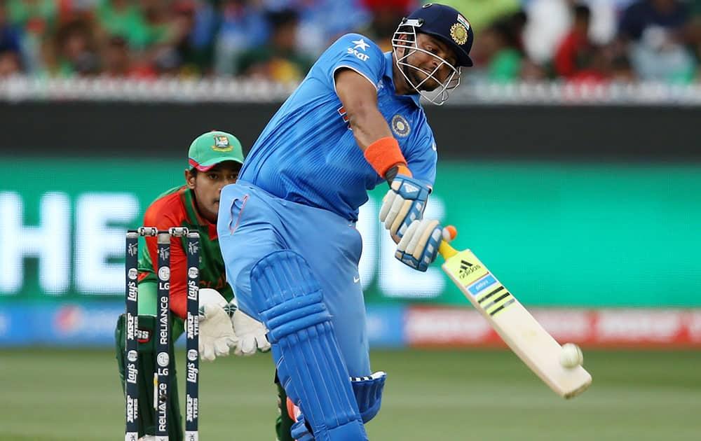 India's Suresh Raina hits the ball for six runs while batting against Bangladesh during their Cricket World Cup quarterfinal match in Melbourne, Australia.