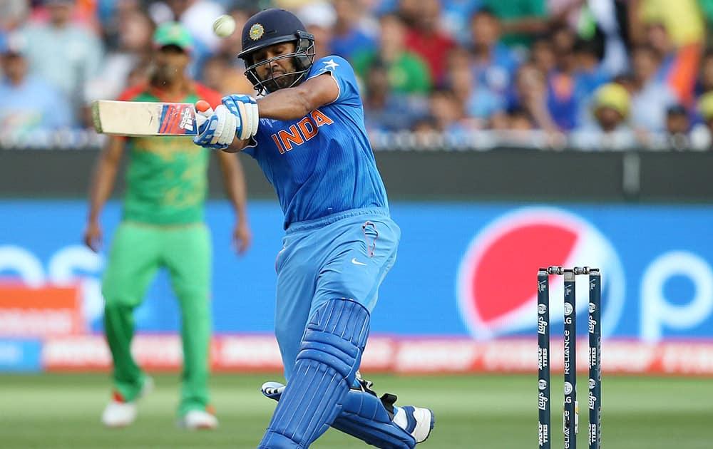 Rohit Sharma hits the ball while batting against Bangladesh during their Cricket World Cup quarterfinal match in Melbourne, Australia.