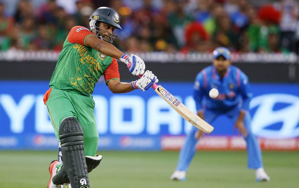 Bangladesh's Tamim Iqbal plays a shot while batting against India during their Cricket World Cup quarterfinal match in Melbourne, Australia.