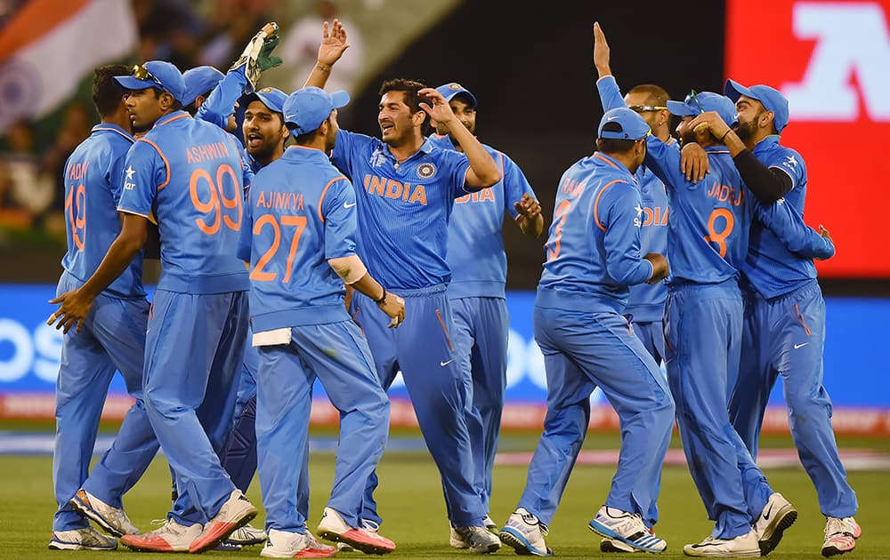 Players celebrate the run out of Bangladesh's Imrul Kayes during their Cricket World Cup quarterfinal match in Melbourne.