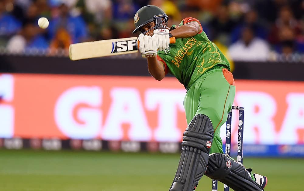 Bangladesh's Mahmudullah hits the ball while batting against India during their Cricket World Cup quarterfinal match in Melbourne.