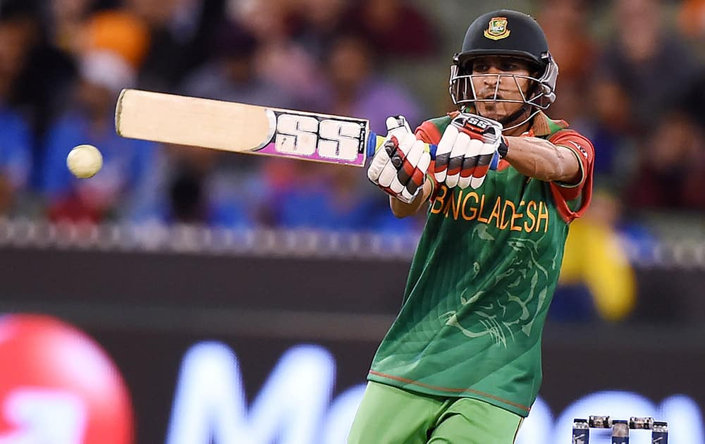 Bangladesh's Nasir Hossain hits the ball while batting against India during their Cricket World Cup quarterfinal match in Melbourne, Australia.