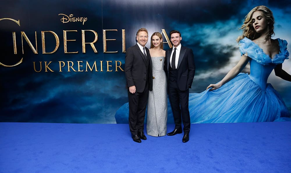 Director Kenneth Branagh, Lily James and Richard Madden pose for photographers upon arrival at the premiere of the film Cinderella in London.