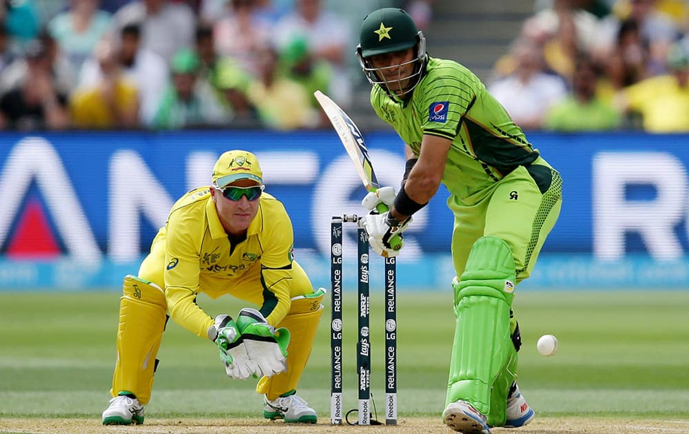 Pakistan's captain Misbah Ul Haq looks to play a shot as Australia's wicketkeeper Brad Haddin watches during their Cricket World Cup quarterfinal match in Adelaide.