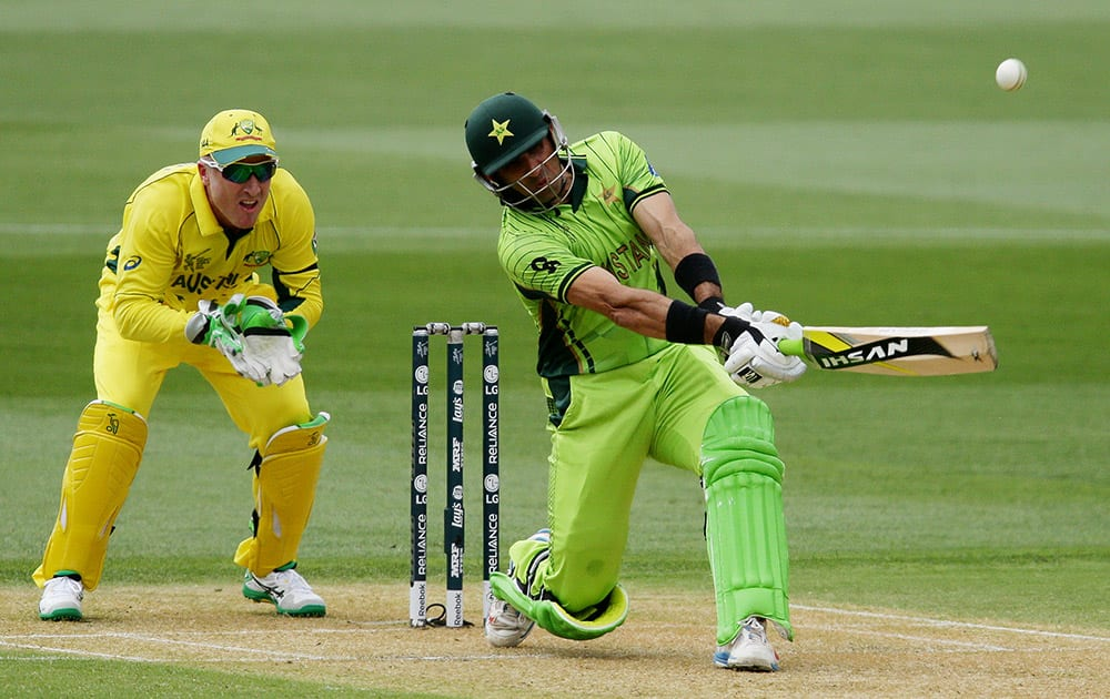 Pakistan's captain Misbah Ul Haq hits the ball as Australia's wicketkeeper Brad Haddin watches during their Cricket World Cup quarterfinal match in Adelaide.