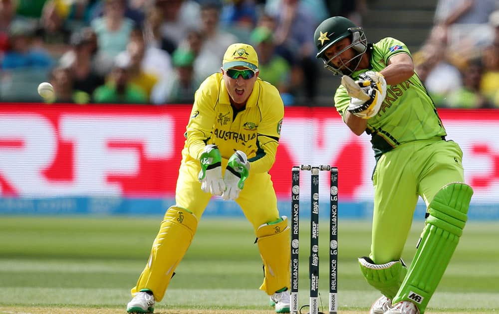 Pakistan's Shahid Afridi hits the ball as Australia's wicketkeeper Brad Haddin watches during their Cricket World Cup quarterfinal match in Adelaide, Australia.
