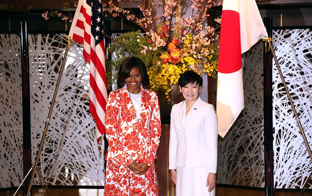 US first lady Michelle Obama and her Japanese counterpart Akie Abe pose at Iikura Guest House in Tokyo.