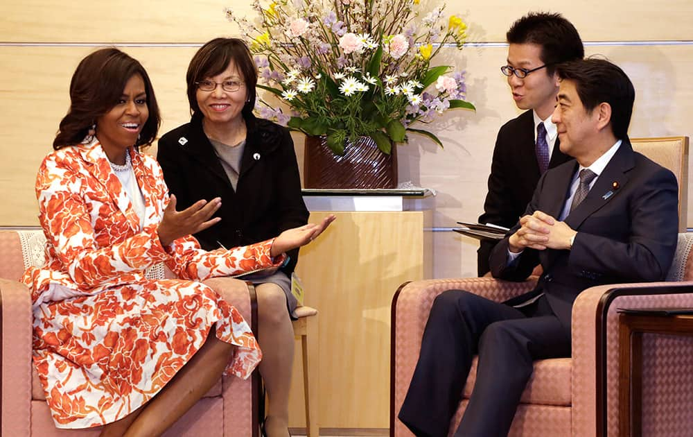 US first lady Michelle Obama, talks with Japanese Prime Minister Shinzo Abe, during a meeting at the prime minister's official residence in Tokyo.