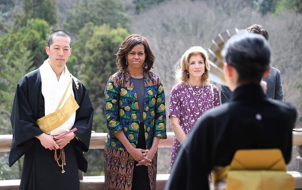 US first lady Michelle Obama, watches a Noh performance by local college students, with monk of Kiyomizu-dera Buddhist temple, Eigen Onishi, left, US Ambassador to Japan Caroline Kennedy, at the temple in Kyoto, western Japan.