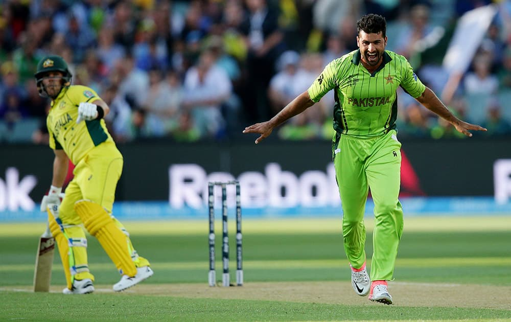 Pakistan's Sohail Khan celebrates after taking the wicket of Australia's Aaron Finch during their Cricket World Cup quarterfinal match in Adelaide, Australia.