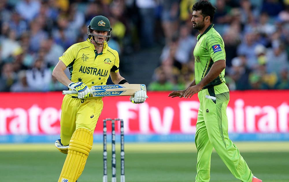 Australian batsman Steve Smith runs around Pakistan's Sohail Khan during their Cricket World Cup quarterfinal match in Adelaide, Australia.