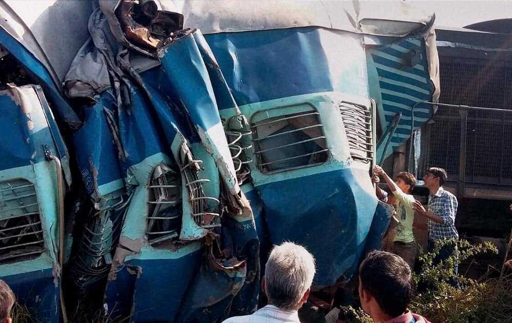 The damaged coaches after the Dehradun-Varanasi Janata Express derailed at the Bachhrawan railway station in Raebareli.