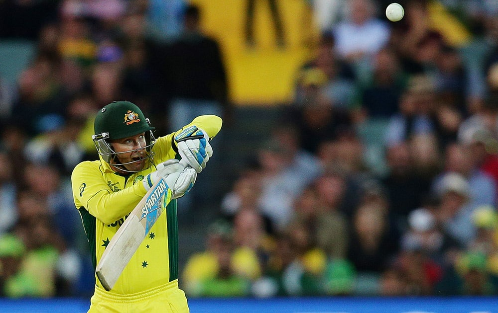 Australia's Michael Clarke watches as he hits the ball to a Pakistan fielder Sohaib Maqsood to be dismissed for eight runs during their Cricket World Cup quarterfinal match in Adelaide, Australia.