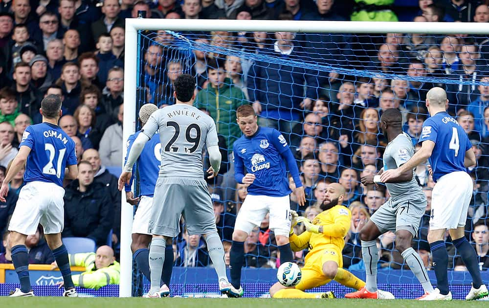 Everton Goalkeeper Tim Howard makes a save on the line during the English Premier League soccer match between Everton and Newcastle United at Goodison Park, Liverpool, England.