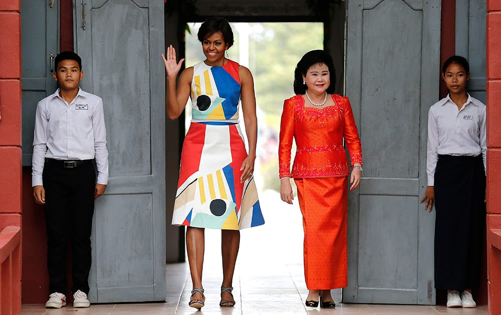 US first lady Michelle Obama and Bun Rany, the first lady of Cambodia, arrive to meet with students at a local high school.