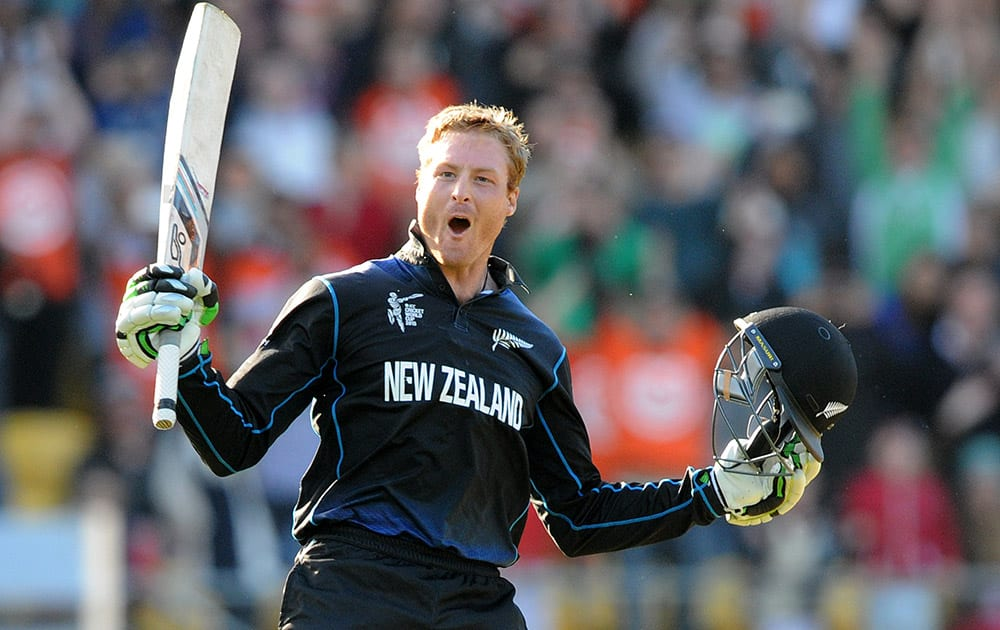New Zealand's Martin Guptill celebrates after scoring a double century while batting against the West Indies during their Cricket World Cup quarterfinal match in Wellington.