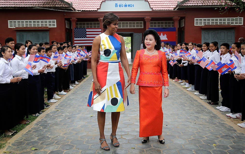 US first lady Michelle Obama and Bun Rany, the first lady of Cambodia, center right, arrive to meet with students at a local high school.