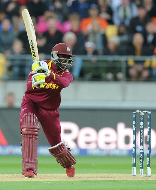 West Indies batsman Jonathan Carter plays a shot while batting against New Zealand during their Cricket World Cup quarterfinal match in Wellington.