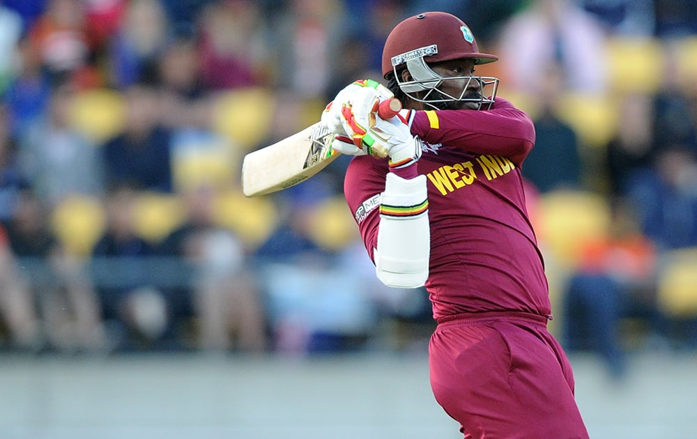 West Indies batsman Chris Gayle plays a shot while batting against New Zealand during their Cricket World Cup quarterfinal match in Wellington, New Zealand.