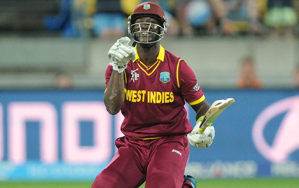 West Indies batsman Darren Sammy gestures after falling over while batting against New Zealand during their Cricket World Cup quarterfinal match in Wellington.