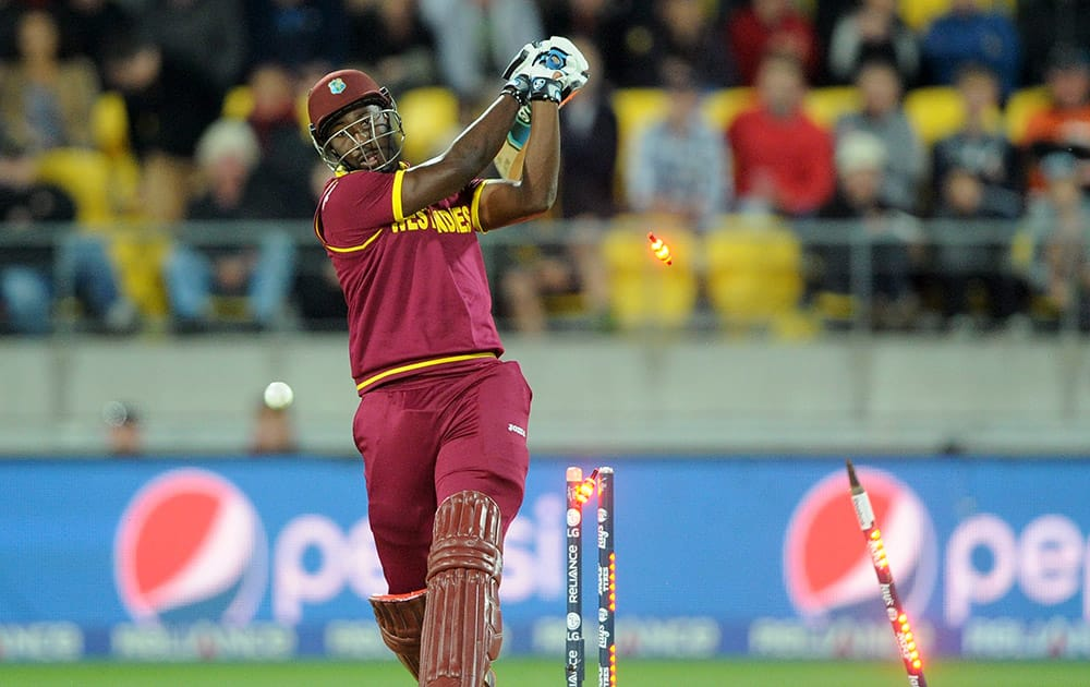 West Indies batsman Andre Russell is bowled out for 20 runs while batting against New Zealand during their Cricket World Cup quarterfinal match in Wellington, New Zealand.