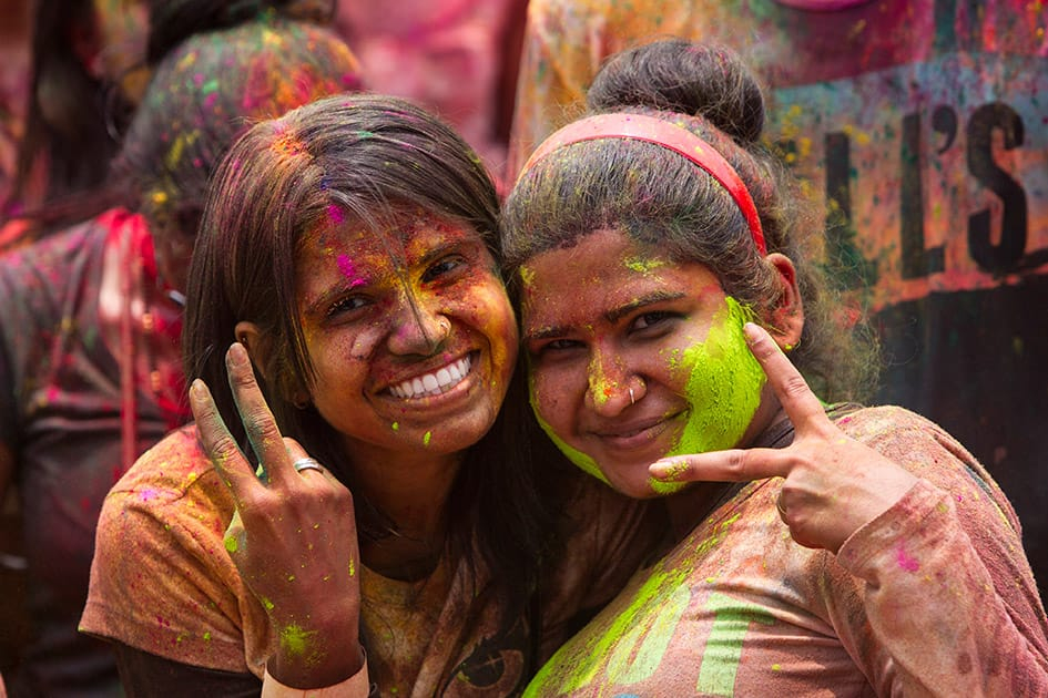 Malaysian-Indian women pose for a photo during the religious spring festival Holi in Kuala Lumpur, Malaysia. Holi, the Hindu festival of colors, is celebrated by people throwing colored powder and water at each other.