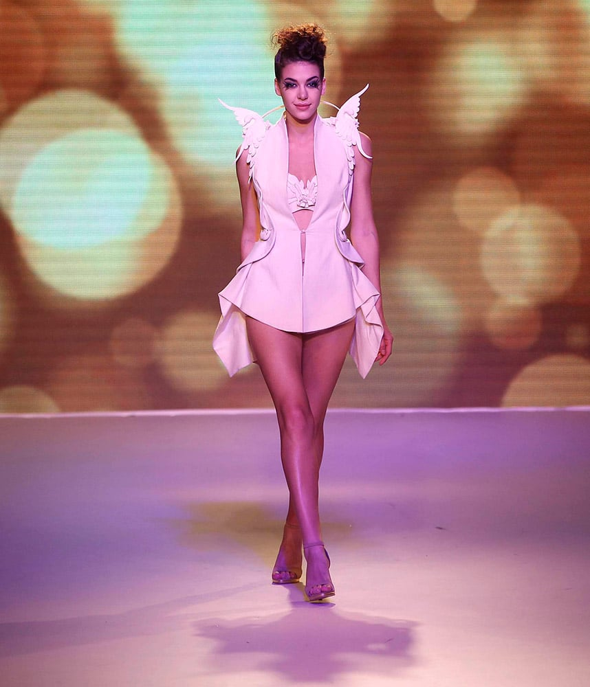A model walks the ramp showcasing an SS Surya creation during the Lakme Fashion Week Summer Resort 2015 in Mumbai.