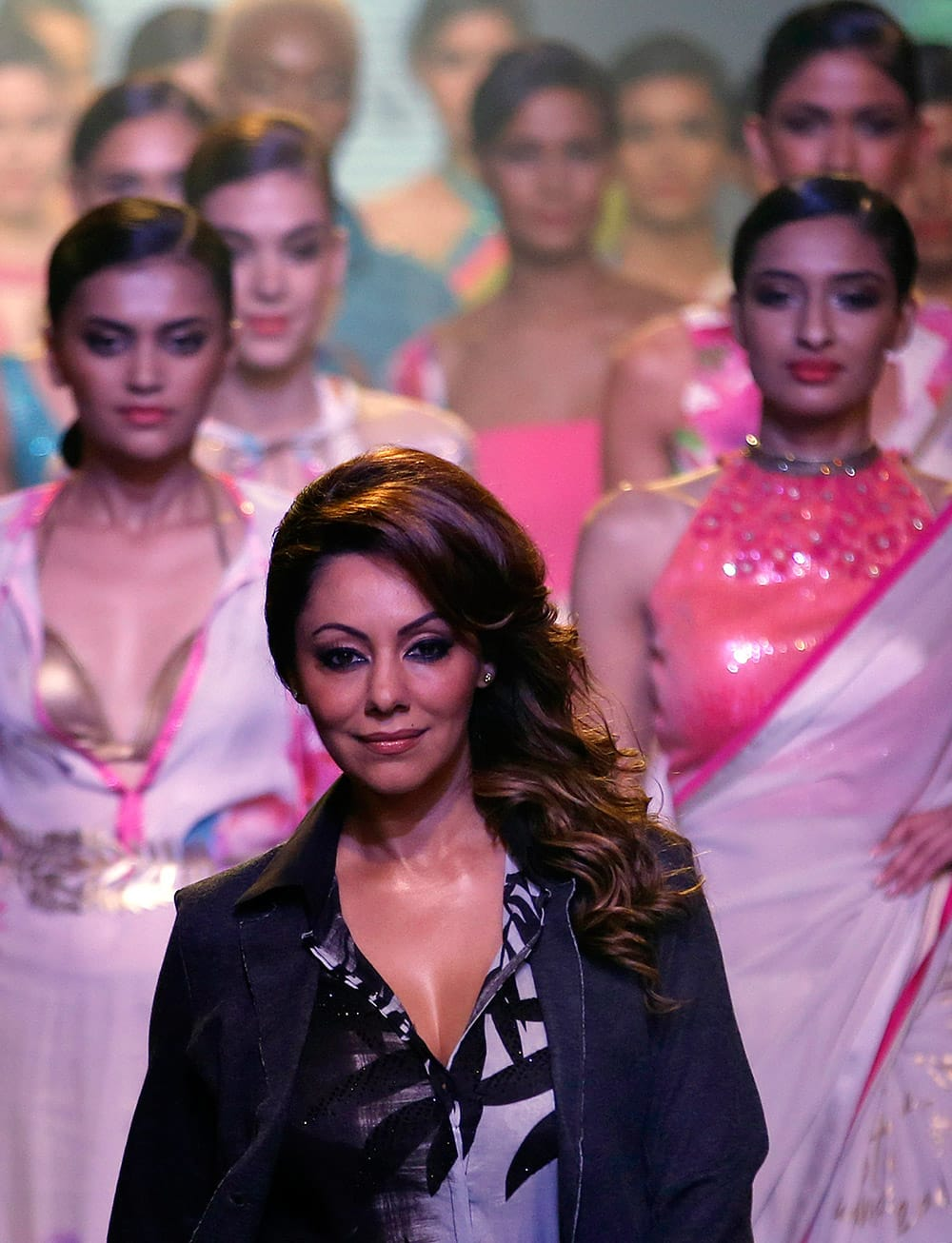 Gauri Khan joins models on the ramp during the Satya Paul by Gauri Khan show at the Lakme Fashion Week Summer Resort 2015 in Mumbai.