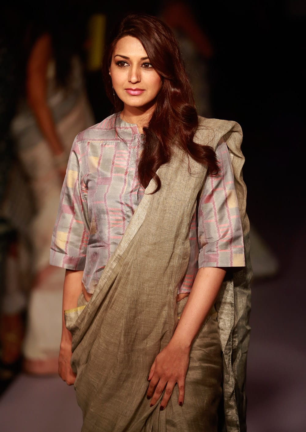 Sonali Bendre poses for photographs during the Lakme Fashion Week Summer Resort 2015 in Mumbai.