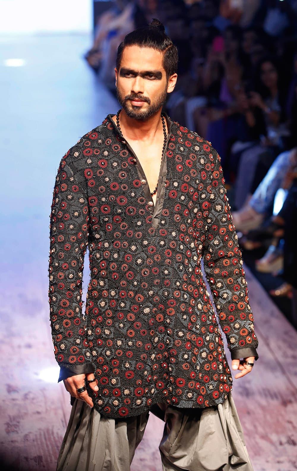 Shahid Kapoor walks the ramp showcasing a Kunal Rawal creation during the Lakme Fashion Week Summer Resort 2015 in Mumbai.