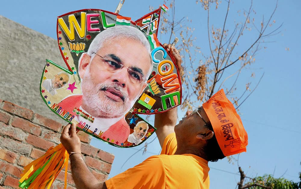 A kite maker showing a kite, emboldened with photograph of Prime Minister Narendra Modi, ahead of the latters arrival in Amritsar on Monday.