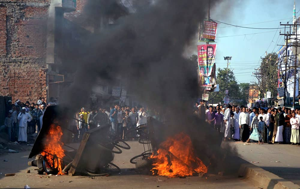 Vehicles and carts set on fire by angry people after death of a Muslim student in Varanasi.