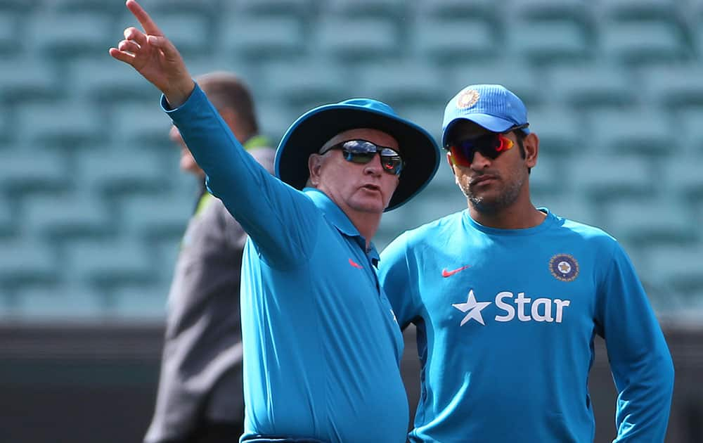 India's cricket captain MS Dhoni, right, talks with head coach Duncan Fletcher as his team arrives to train for their Cricket World Cup semifinal match in Sydney, Australia.