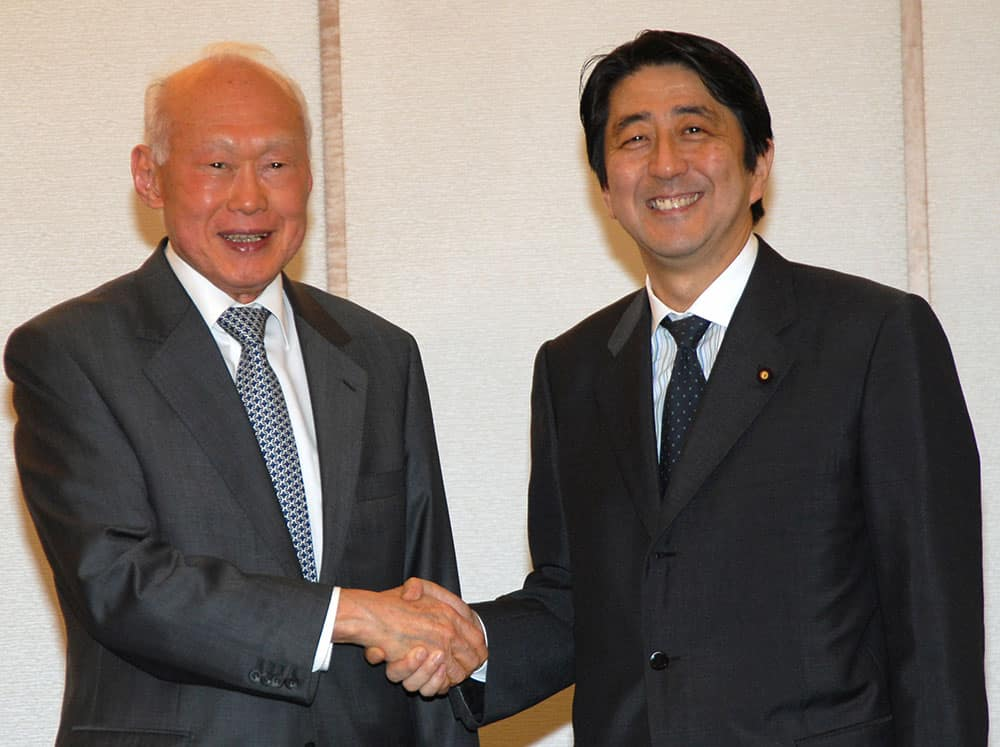 FILE - In this May 24, 2006, file photo, Singapore's then Minister Mentor Lee Kuan Yew, left, shakes hands with then Japanese Chief Cabinet Secretary Shinzo Abe prior to their meeting in Tokyo.