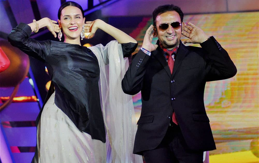 Bollywood actors Neha Dhupia and Gulshan Grover performs during Prag Cine Awards in Dibrugarh.