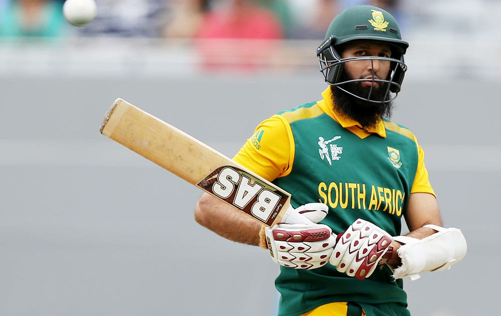 South Africa's Hashim Amla lets a ball pass while batting against New Zealand during their Cricket World Cup semifinal in Auckland, New Zealand.