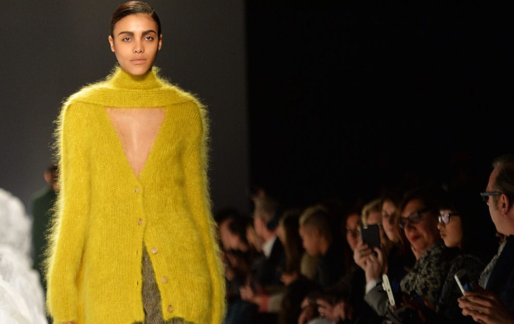 A model walks the runway for the Pink Tartan Fall 2015 collection during Toronto fashion week.