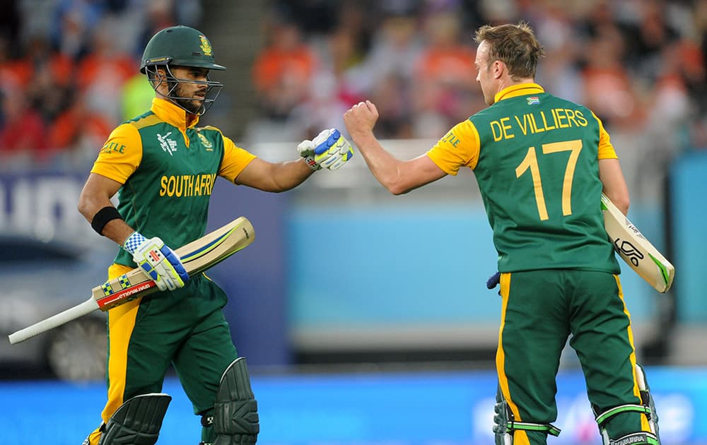 South Africa's AB de Villiers and JP Duminy celebrate after their innings against New Zealand during their Cricket World Cup semifinal in Auckland, New Zealand.