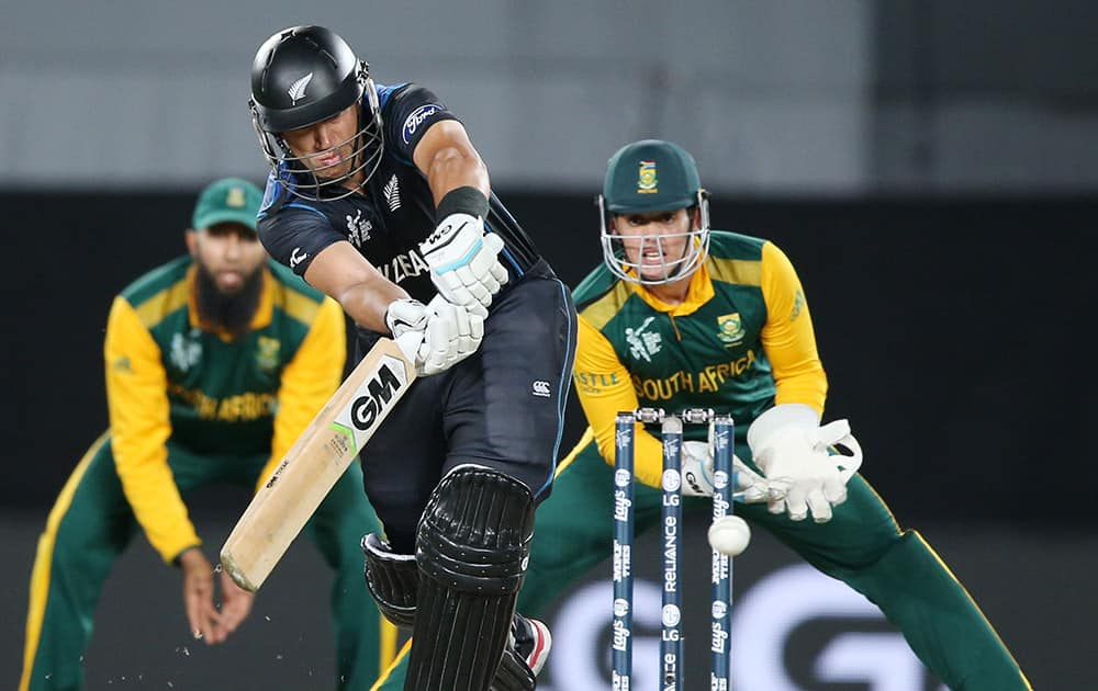 New Zealand's Ross Taylor plays a shot as South African wicketkeeper Quinton De Kock watches during their Cricket World Cup semifinal in Auckland.