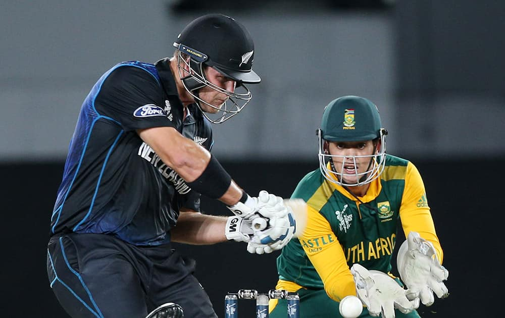 New Zealand's Corey Anderson plays a shot as South African wicketkeeper Quinton De Kock watches during their Cricket World Cup semifinal in Auckland.