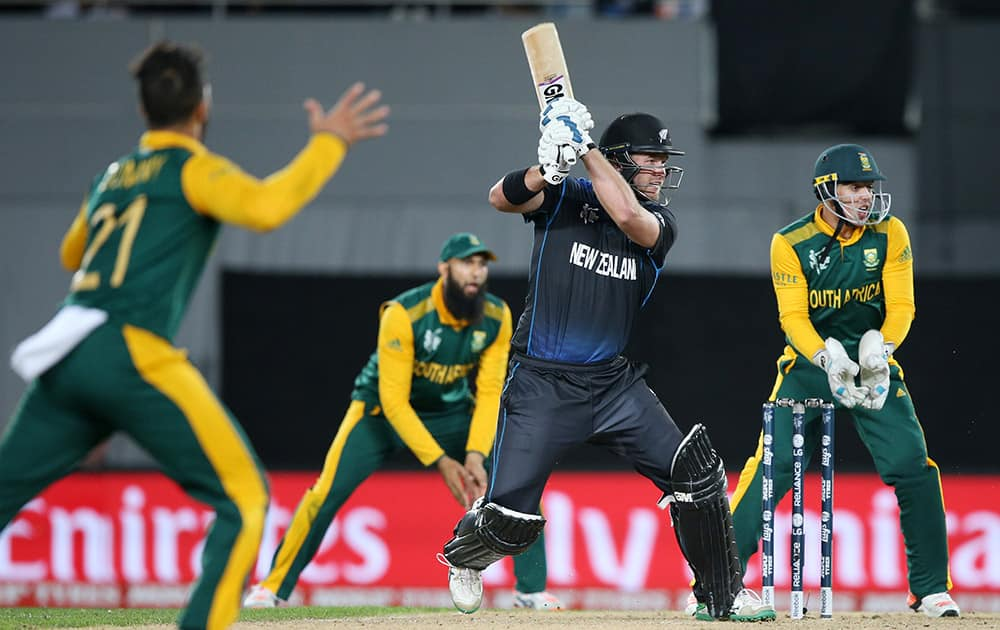 New Zealand's Corey Anderson plays a shot while batting against South Africa during their Cricket World Cup semifinal in Auckland.