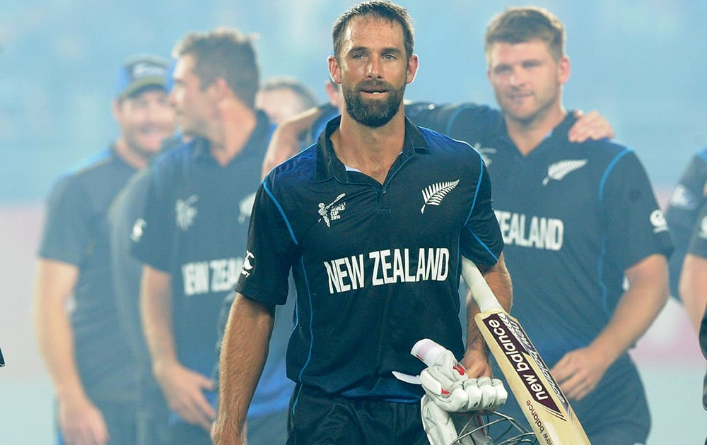 New Zealand's Grant Elliott walks from the field following his teams four wicket win over South Africa in their Cricket World Cup semifinal in Auckland, New Zealand.