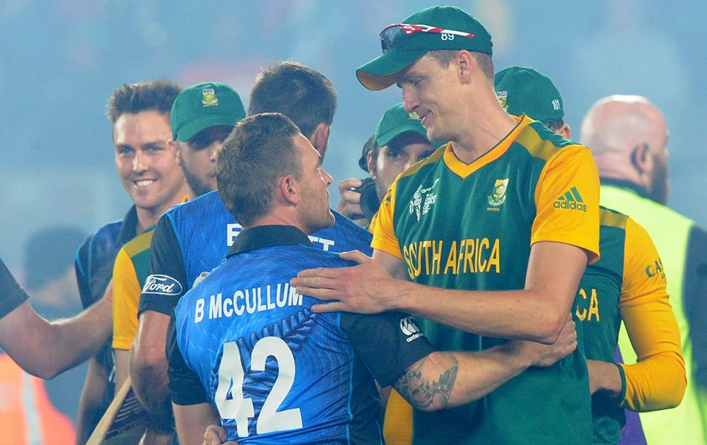 New Zealand's Brendon McCullum embraces South Africa's Morne Morkel after their Cricket World Cup semifinal in Auckland, New Zealand. New Zealand defeated South Africa by four wickets.