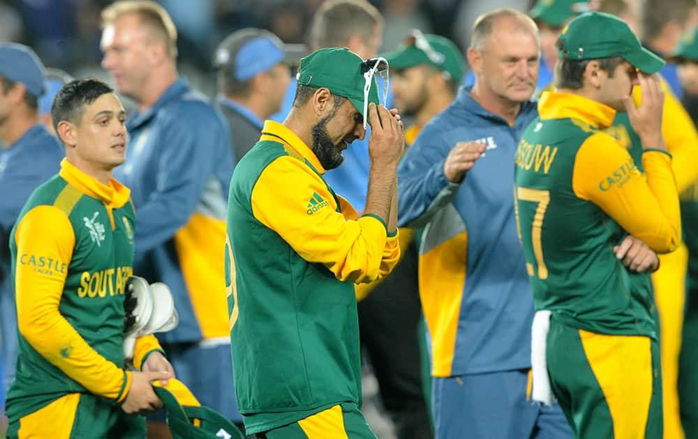 South Africa's Imran Tahir, reacts with his teammates following their four wicket loss to New Zealand in their Cricket World Cup semifinal in Auckland, New Zealand.