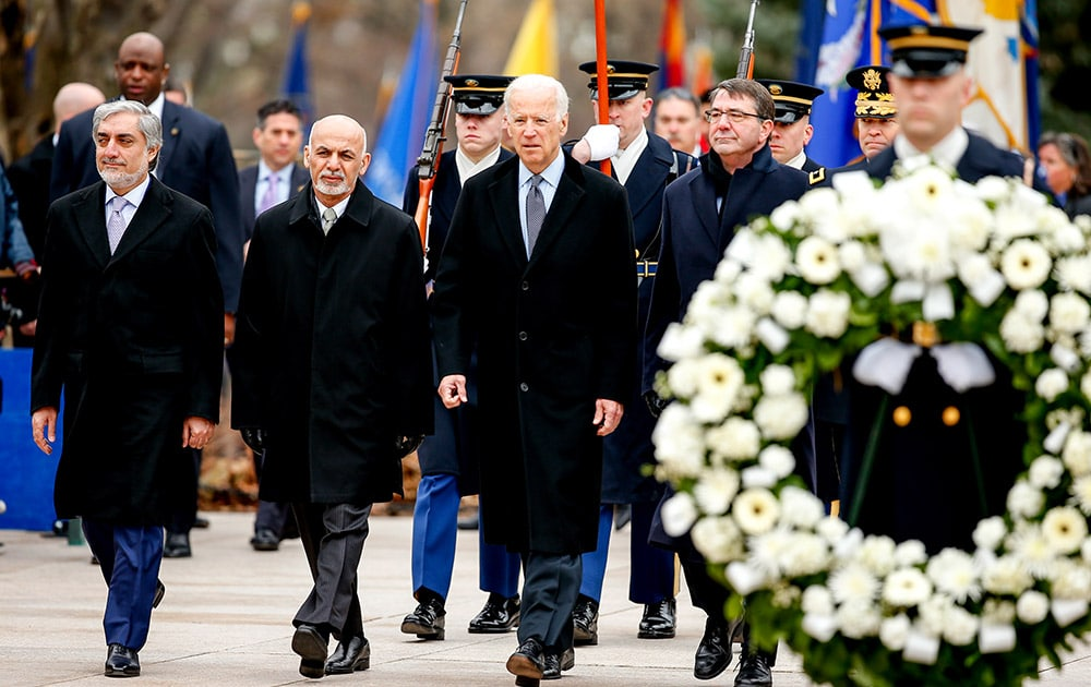 From left, Afghanistan's Chief Executive Officer Abdullah Abdullah, Afghanistan's President Ashraf Ghani, Vice President Joe Bidden, Defense Secretary Ash Carter, and Maj. Gen. Jeffrey Buchanan, commanding general, U.S. Army Military District of Washington, arrive for a wreath laying ceremony at the Tomb of the Unknowns, Tuesday, March 24, 2015, at Arlington National Cemetery in Arlington, Va.
