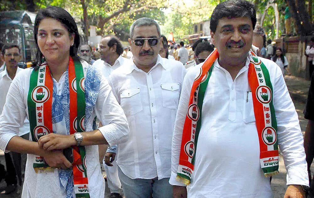 Congress MP Priya Dutt and leader Ashok Chavan during a rally.