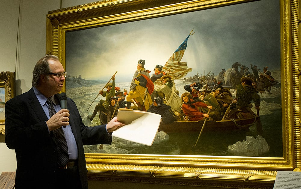 Art dealer John Driscoll points out some of the details in Emanuel Leutze's 1851 painting of 'Washington Crossing the Delaware' during an unveiling at the Minnesota Marine Art Museum in Winona, Minn.