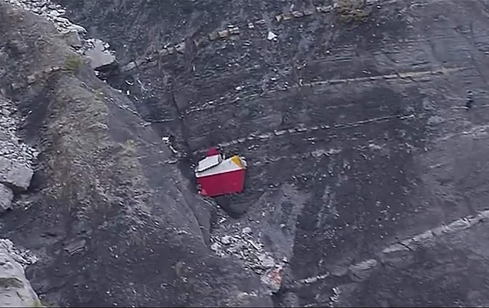 This image made from TV, debris is scattered over the area after a Germanwings Airbus 320 crashed near Seyne-les-Alpes in the French Alps.