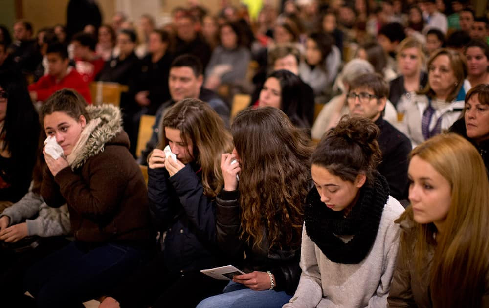 Friends of the German students from the crashed plane attend a mass in Llinars del Valles, near Barcelona, Spain.