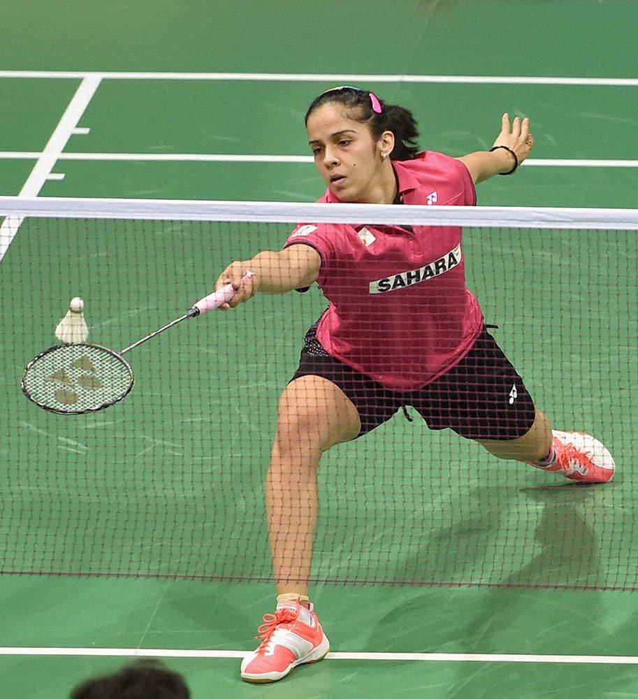 Indian ace shuttler Saina Nehwal plays a shot against Riya Mukherjee at Yonex Sunrise India Open, in New Delhi.